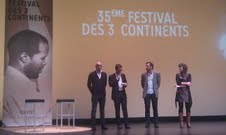 On stage at opening night of the 3Continents Film Festival in Nantes, France - Nicolas Doyard of South African Dept of Arts and Culture announces the participation of Madoda Ncayiyana and Julie Frederikse in Script Studio, with Guillaume Mainguet of Produire au Sud